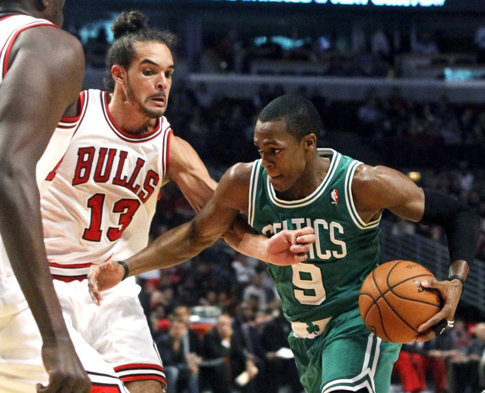 Boston Celtics guard Rajon Rondo (9) drives on Chicago Bulls center Joakim Noah during the first half of an NBA basketball game, Monday, Nov. 12, 2012, in Chicago. (AP Photo/Charles Rex Arbogast)