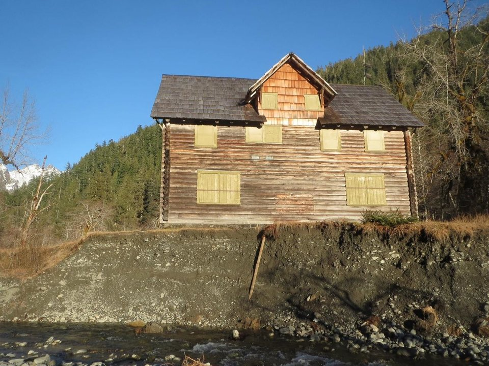 Photo - FILE - In this undated file photo provided by Olympic National Park, the Enchanted Valley Chalet stands just feet from the Quinault River in Olympic National Park in Washington state. The park says it is moving forward with a plan to move the chalet that is being threatened by the shifting east fork of the river. (AP Photo/Olympic National Park, File)