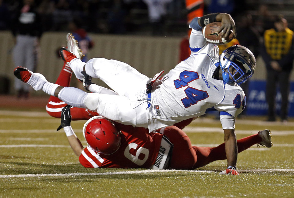Photo - Millwood's Larry Lambeth dives in for a touchdown as Hunter Karlik tackles during the Class 2A state football championship game between Davis and Millwood at Moore High School in Moore, Okla.,  Thursday, Dec. 19, 2013. Photo by Sarah Phipps, The Oklahoman