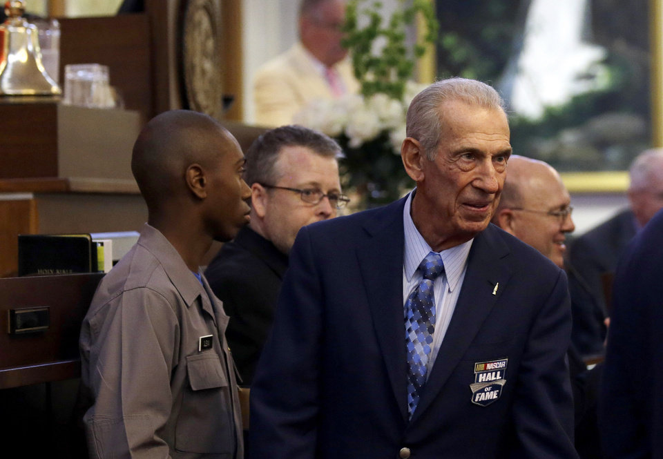 Photo - NASCAR racing legend Ned Jarrett is welcomed on the House floor during the opening session of the General Assembly in Raleigh, N.C., Wednesday, May 14, 2014 where lawmakers honored NASCAR Hall of Fame inductees. (AP Photo)