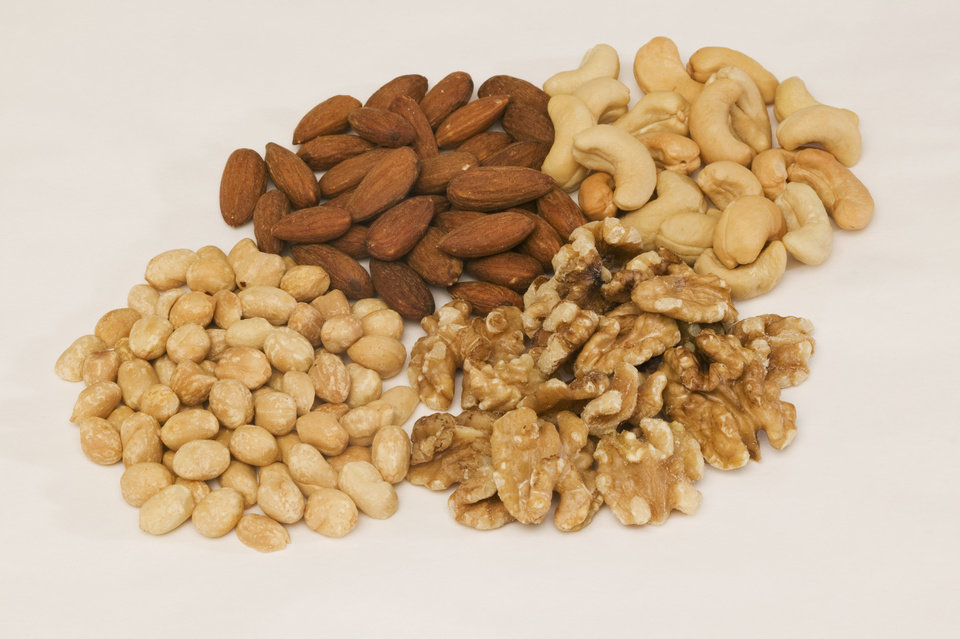 Photo -  Many cultures and diets known for healthy eating use nuts liberally.   Jupiterimages -