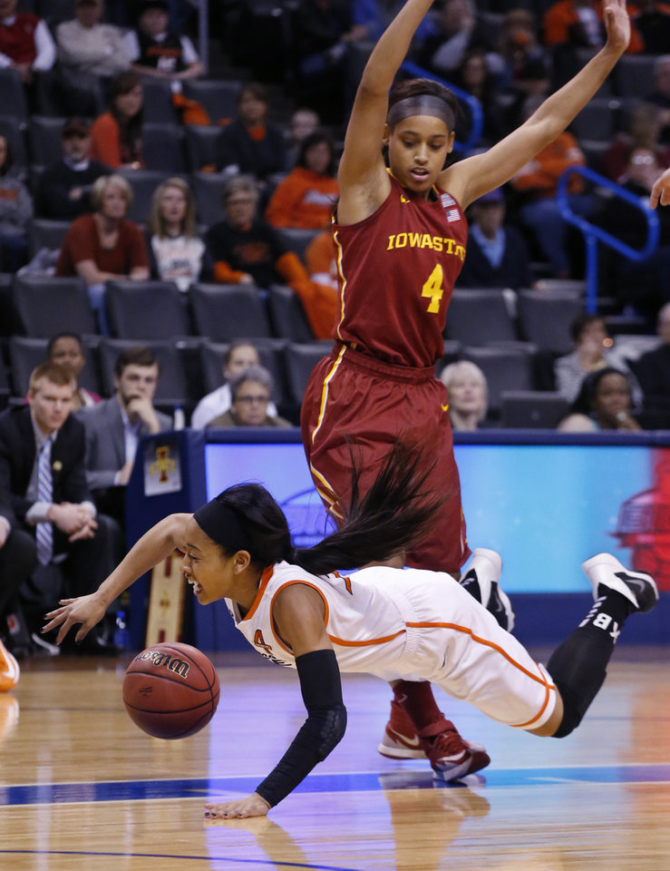 Photo - Oklahoma State guard Tiffany Bias (3) falls in front of Iowa State guard Nikki Moody (4) as she drives to the basket in the first half of an NCAA college basketball game in the quarterfinals of the Big 12 Conference women's college tournament in Oklahoma City, Saturday, March 8, 2014. (AP Photo/Sue Ogrocki)
