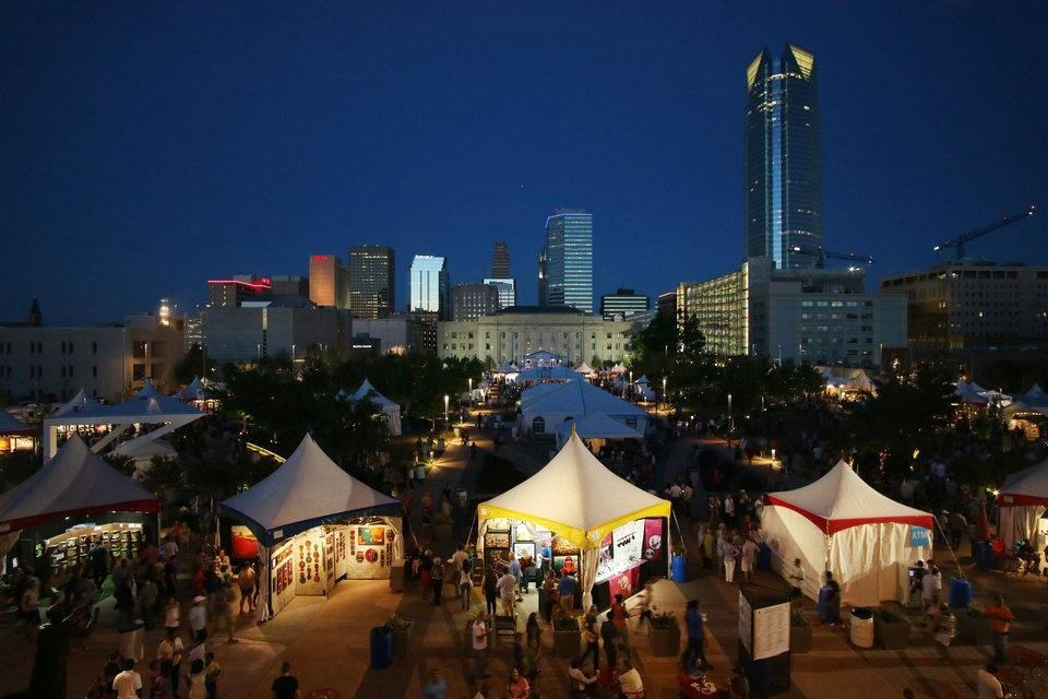 Photo - People gather at the 2016 Festival of the Arts at Bicentennial Park in Downtown Oklahoma City Friday, April 22, 2016. [Doug Hoke/The Oklahoman Archives]