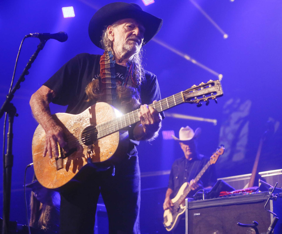 File-This March 15, 2014, file photo shows Willie Nelson performing at the iTunes Festival during the SXSW Music Festival in Austin, Texas. The country music icon who already had a downtown street and 8-foot statue in his honor in Austin added a spot in the inaugural class of the Austin City Limits Hall of Fame on Saturday, April 26, 2014. (Photo by Jack Plunkett/Invision/AP, File)