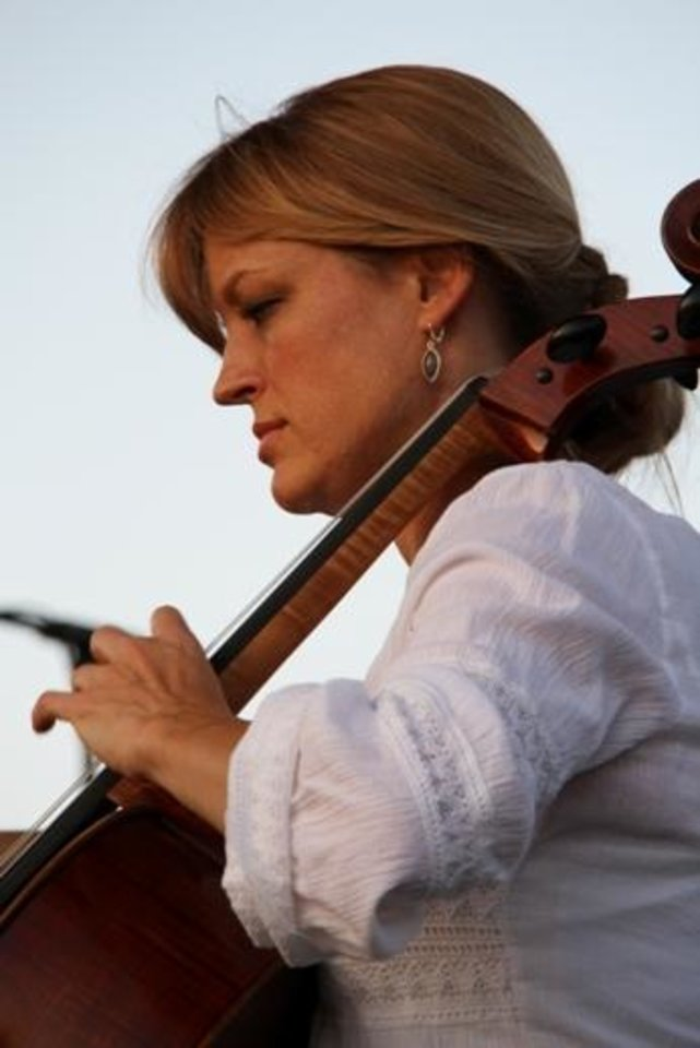 Photo -  A member of the Oklahoma City Philharmonic performs at the 2012 Oklahoma Arts Festival on the campus of Oklahoma City Community College. Photo provided
