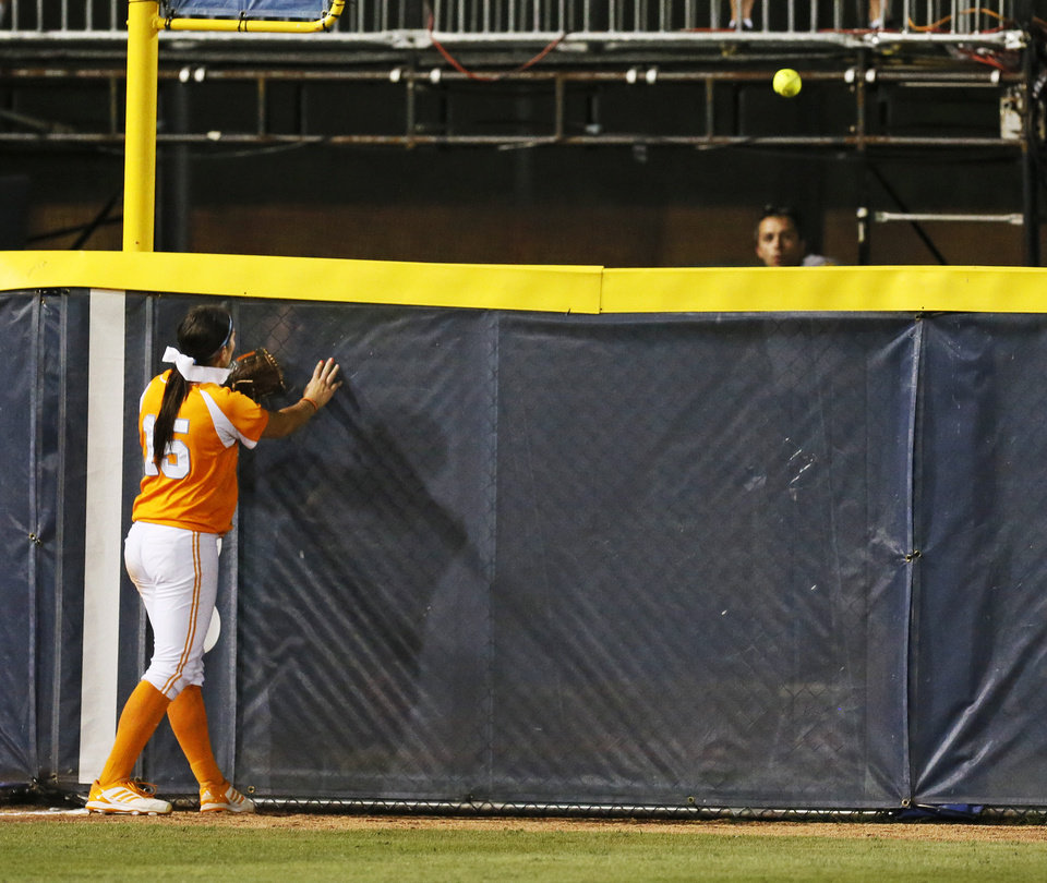 Photo - Tennessee's Melissa Davin (15) watches the game-winning home run, hit by OU's Lauren Chamberlain (44), leave the field in the twelfth inning during Game 1 of the Women's College World Series NCAA softball championship series between Oklahoma and Tennessee at ASA Hall of Fame Stadium in Oklahoma City, Monday, June 3, 2013. OU won 5-3 in 12 innings. Photo by Nate Billings, The Oklahoman