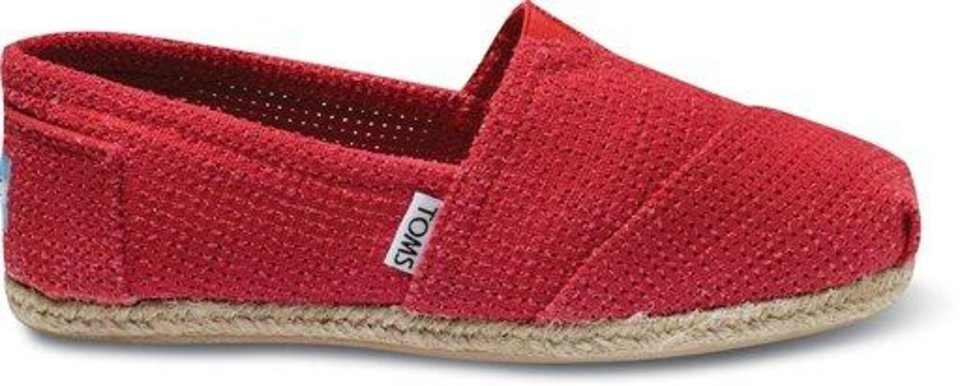 In this undated image provided by Toms, a Fushia Freetown 2 shoe from the spring-summer '12 collection is seen. Music star Lenny Kravitz was the guest designer for the collection. (AP Photo/Toms)