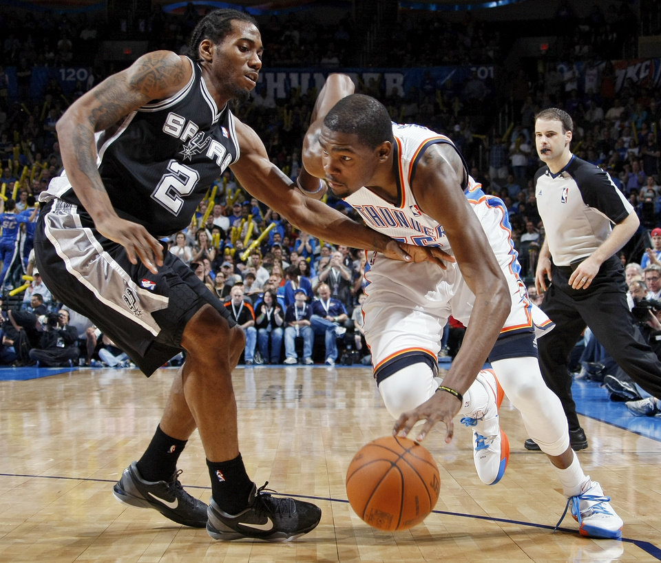 Photo - Oklahoma City's Kevin Durant (35) drives the ball against San Antonio's Kawhi Leonard (2) during the NBA basketball game between the Oklahoma City Thunder and the San Antonio Spurs at Chesapeake Energy Arena in Oklahoma City, Friday, March 16, 2012. San Antonio won, 114-105. Photo by Nate Billings, The Oklahoman