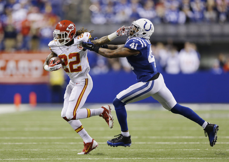 Photo - Kansas City Chiefs wide receiver Dexter McCluster (22) runs against Indianapolis Colts strong safety Antoine Bethea (41) during the second half of an NFL wild-card playoff football game Saturday, Jan. 4, 2014, in Indianapolis. Indianapolis defeated Kansas City 45-44. (AP Photo/Michael Conroy)