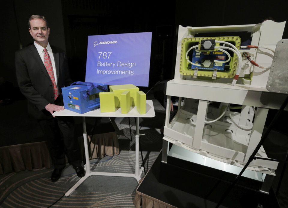Boeing Commercial Airplanes Vice President and Chief Project Engineer Mike Sinnett poses with a model of newly designed 787\'s battery for photographers during a news conference in Tokyo, Friday, March 15, 2013. Boeing executives said commercial flights of its grounded 787 jets will resume