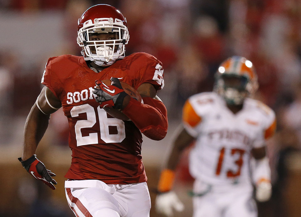 Oklahoma's Damien Williams (26) runs for a touchdown during the college football game between the University of Oklahoma Sooners (OU) and Florida A&M Rattlers at Gaylord Family—Oklahoma Memorial Stadium in Norman, Okla., Saturday, Sept. 8, 2012. Photo by Bryan Terry, The Oklahoman