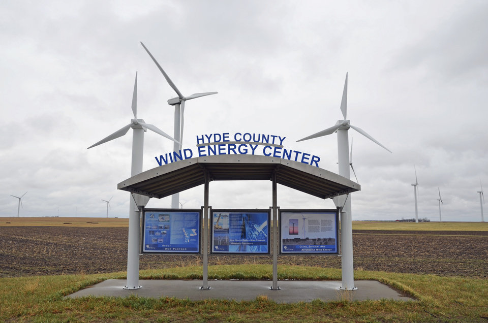 Photo - The South Dakota Wind Energy Center is seen Tuesday, April 29, 2014, near Highmore, S.D., where a single-engine Piper crashed in foggy weather Sunday evening after it apparently hit the blade of the one of the wind turbines. The pilot and three cattlemen returning from a sale of live cattle and embryos were killed in the crash. (AP Photo/Capital Journal, Joel Ebert)