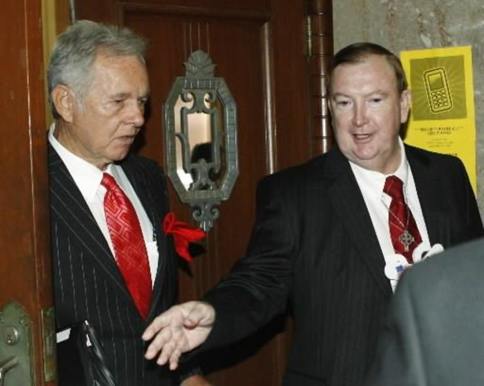 Jerome Ersland, right, is seen in this file photo.
