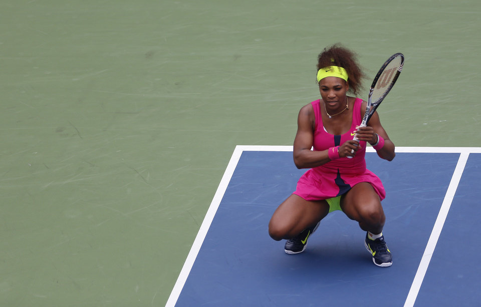 Photo -   Serena Williams rreacts during her match against Czech Republic's Andrea Hlavackova in the fourth round of play at the 2012 US Open tennis tournament, Monday, Sept. 3, 2012, in New York. (AP Photo/Julio Cortez)