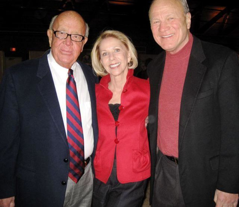 Photo - LEE ALLAN SMITH DAY....Bill Wallace and Becky and Barry Switzer were at the party for Lee Allen Smith. (Photo by Helen Ford Wallace).