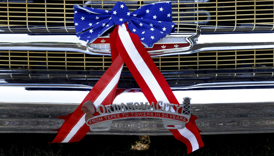 Jerry Webb's 1957 Chevy is decorated with stars and stripes ribbons during Freedom Festival at Eldon Lyon Park in Bethany, Wednesday, July 4, 2012. Photo By Steve Gooch, The Oklahoman