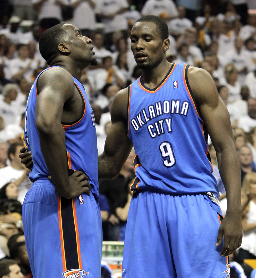 Photo - Oklahoma City Thunder forward Serge Ibaka (9) consoles Kendrick Perkins, left, in the final moments of the overtime period against the Memphis Grizzlies in Game 3 of a second-round NBA basketball series on Saturday, May 7, 2011, in Memphis, Tenn. The Grizzlies won 101-93 in overtime to take a 2-1 lead in the series. (AP Photo/Lance Murphey)