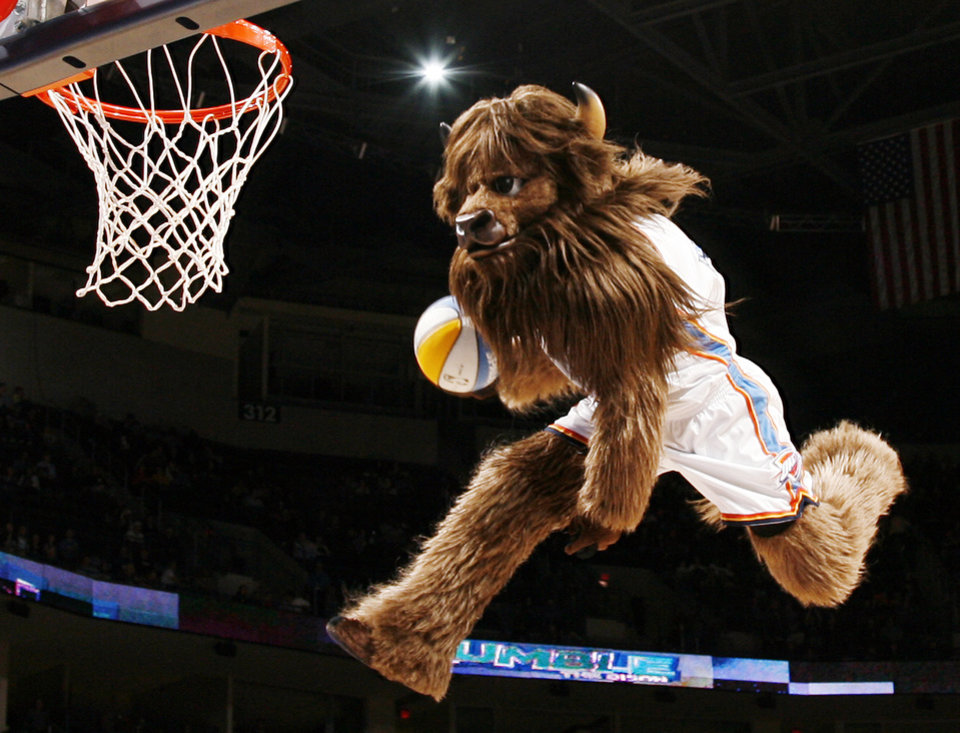 Oklahoma City mascot Rumble the Bison dunks the ball during the NBA preseason game between the Sacramento Kings and the Oklahoma City Thunder at the Ford Center in Oklahoma City, Thursday, Oct. 22, 2009. Photo by Nate Billings, The Oklahoman