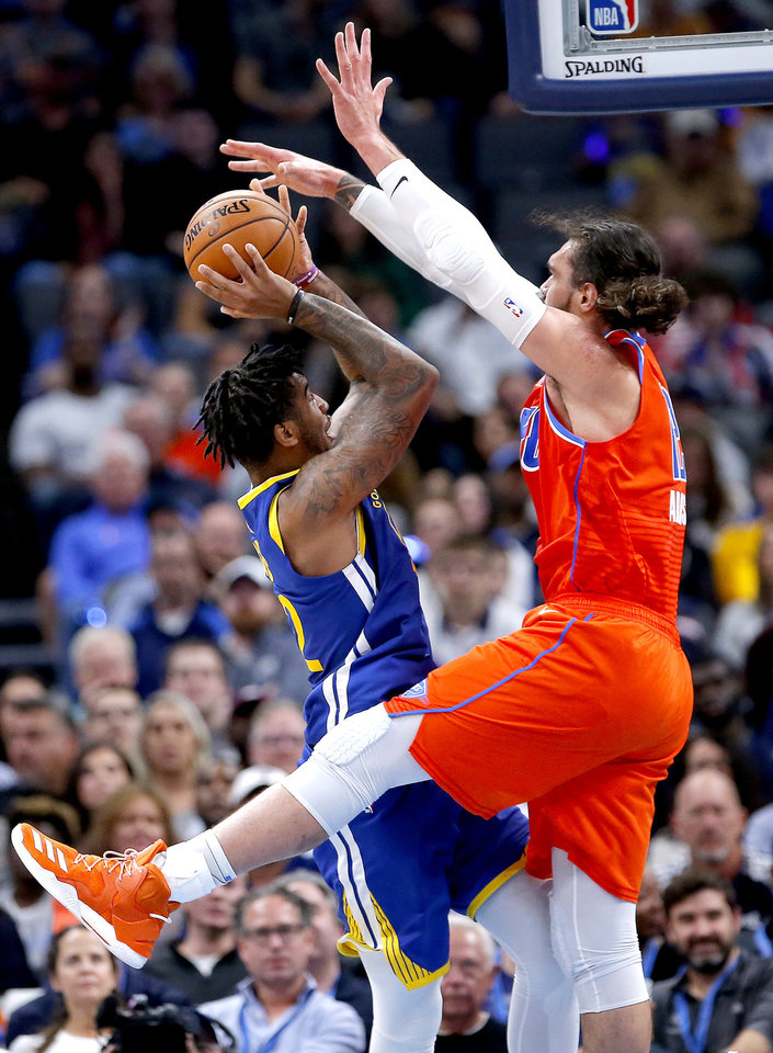 Photo - Oklahoma City's Steven Adams (12) defends against Golden State's Marquese Chriss (32) during the NBA game between the Oklahoma City Thunder and Golden State Warriors at Chesapeake Energy Arena,  Sunday, Oct. 27, 2019. Thunder won 120-92.[Sarah Phipps/The Oklahoman]