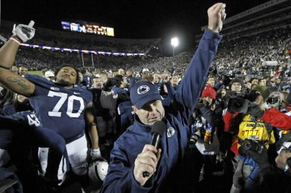 Penn State coach Bill O'Brien celebrates with his team after a 24-21, overtime win over Wisconsin in the Nittany Lions' season finale. AP PHOTO