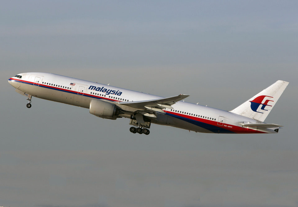 Photo - In this Nov. 15, 2012 photo, a Malaysia Airlines Boeing 777-200 takes off from Los Angeles International Airport in Los Angeles.  The plane, with the tail number 9M-MRD, is the same aircraft that was heading from Amsterdam to Kuala Lumpur on Thursday, July 17, 2014 when it was shot down near the Ukraine Russia border, according to Anton Gerashenko, an adviser to Ukraine's interior minister. (AP Photo/JoePriesAviation.net)