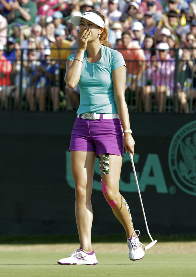 Photo - Michelle Wie reacts after winning the U.S. Women's Open golf tournament in Pinehurst, N.C., Sunday, June 22, 2014. (AP Photo/Bob Leverone)