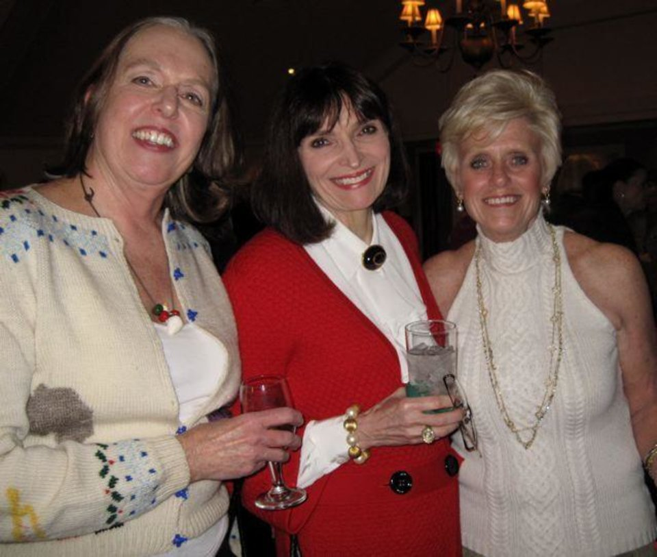 JUST GIRLS....Franci Hart, Betsy Hyde and Linda Carpenter celebrate the season. Carpenter, Terry Bradley, Dianne Meacham and Connie Naifeh were hostesses at a party at the Oklahoma City Golf and Country Club. (Photo by Helen Ford Wallace)