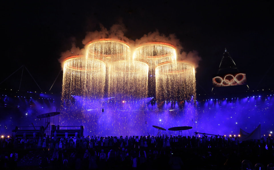 The Olympic rings are lit with pyrotechnics during the Opening Ceremony at the 2012 Summer Olympics, Friday, July 27, 2012, in London. (AP Photo/David Goldman)