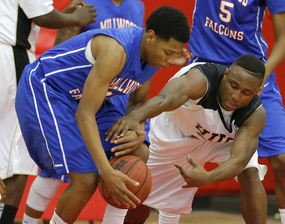 Hugo\'s Trey Johnson, at right, fights for the ball with Millwood\'s Michael Mays during a Class 3A boys state basketball tournament game between Hugo and Millwood at Yukon High School in Yukon, Okla., Thursday, March 7, 2013. Photo by Bryan Terry, The Oklahoman