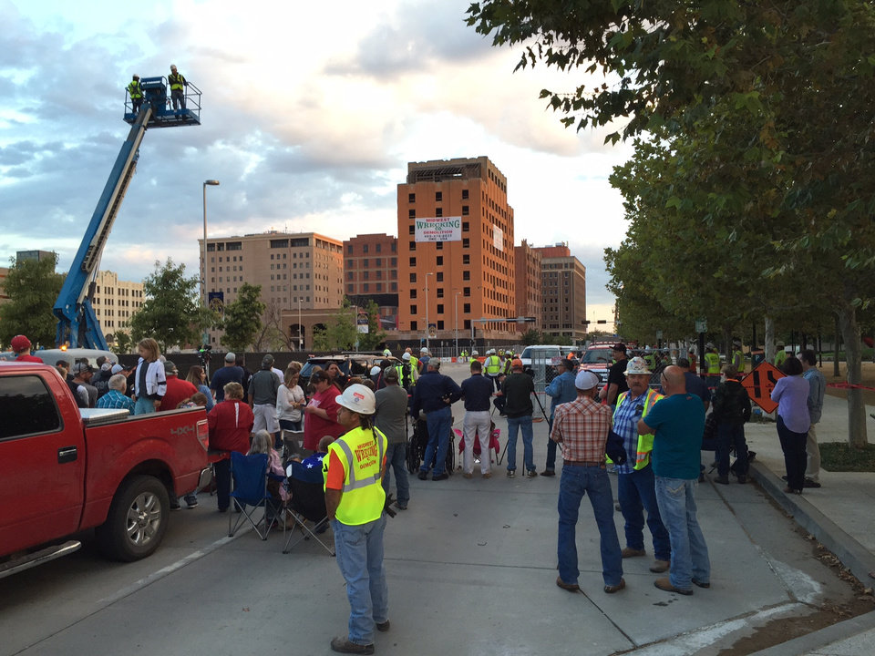 Photo - Crowds gather in downtown Oklahoma City to watch the implosions of two historic hotels on Hudson Avenue. Photo by James Beckel, The Oklahoman.