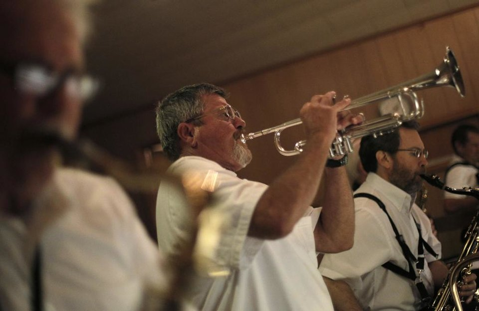 Photo -  Mike Neilsen plays trumpet with the Milo Schedeck band at Czech Hall in Yukon, Okla., Saturday, Sept. 29, 2012.  Photo by Garett Fisbeck, The Oklahoman