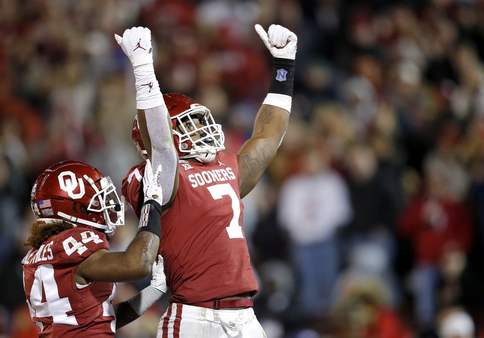 Photo - Oklahoma's Ronnie Perkins (7) and Brendan Radley-Hiles (44) celebrate a play in the fourth quarter during an NCAA football game between the University of Oklahoma Sooners (OU) and the TCU Horned Frogs at Gaylord Family-Oklahoma Memorial Stadium in Norman, Okla., Saturday, Nov. 23, 2019. OU won 28-24. [Sarah Phipps/The Oklahoman]