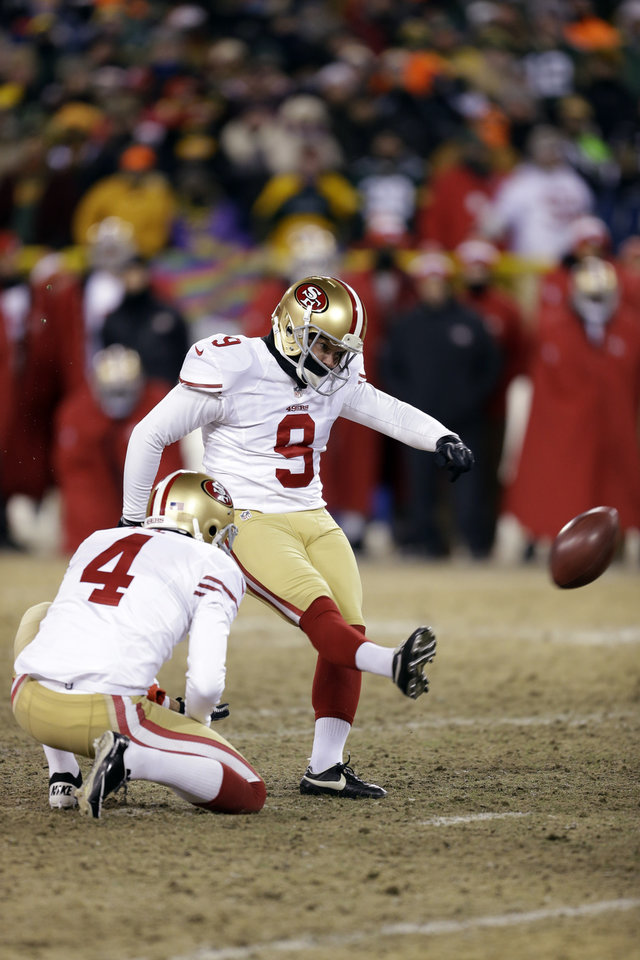 Photo - San Francisco 49ers kicker Phil Dawson (9) kicks the game-winning field goal during the second half of an NFL wild-card playoff football game against the Green Bay Packers, Sunday, Jan. 5, 2014, in Green Bay, Wis. The 49ers won 23-20. (AP Photo/Mike Roemer)