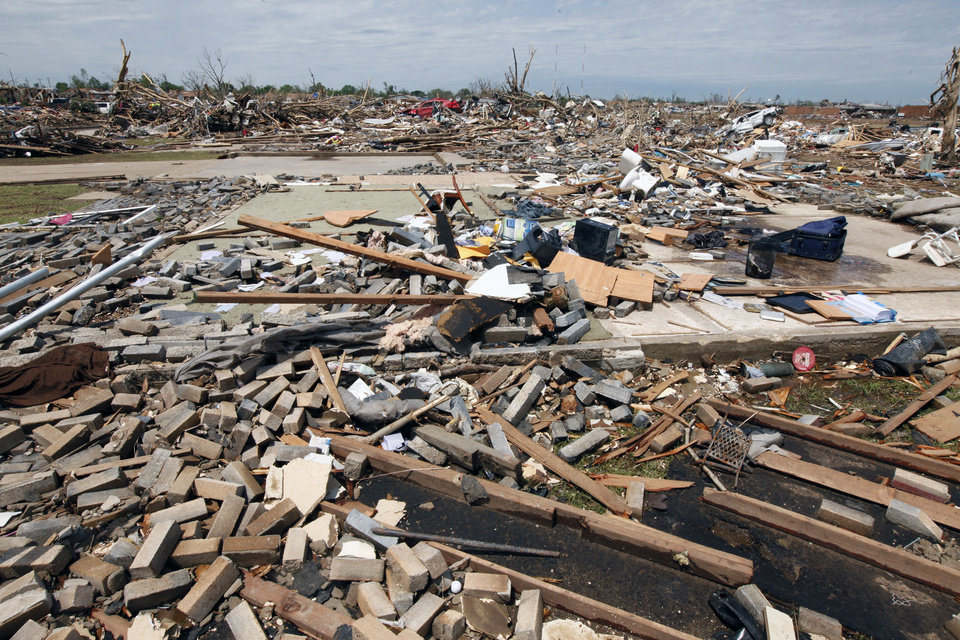 Photo - This is the remains of a home in the tornado devastated part of Moore, OK, Thursday, May 23, 2013. A man was killed by the tornado at this house.  Photo by Paul Hellstern, The Oklahoman