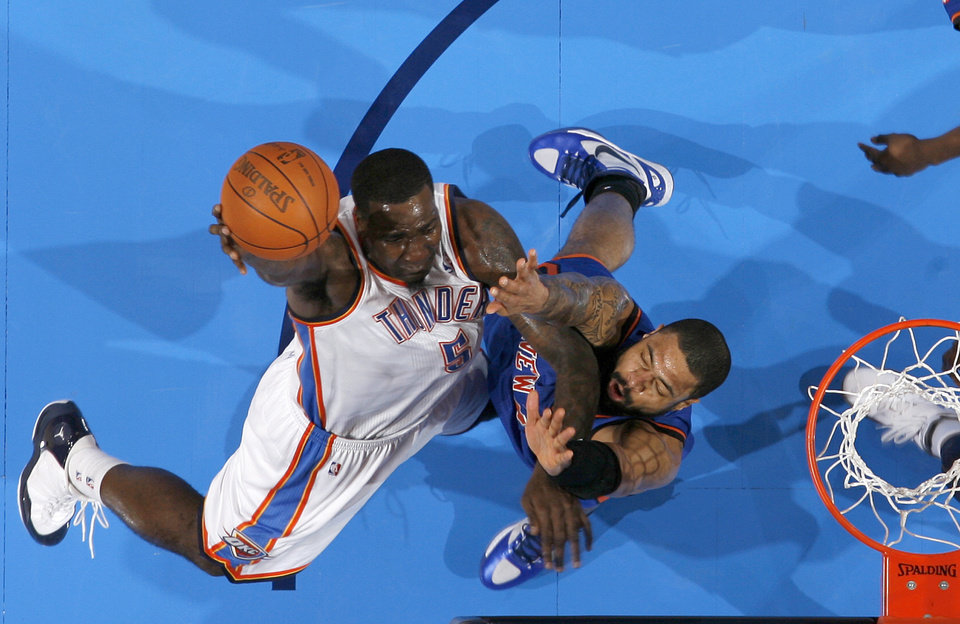 Photo - Oklahoma City's Kendrick Perkins (5) drives to the basket beside New York's Tyson Chandler (6) during the NBA game between the Oklahoma City Thunder and the New York Knicks at Chesapeake Energy Arena in Oklahoma CIty, Saturday, Jan. 14, 2012. Photo by Bryan Terry, The Oklahoman