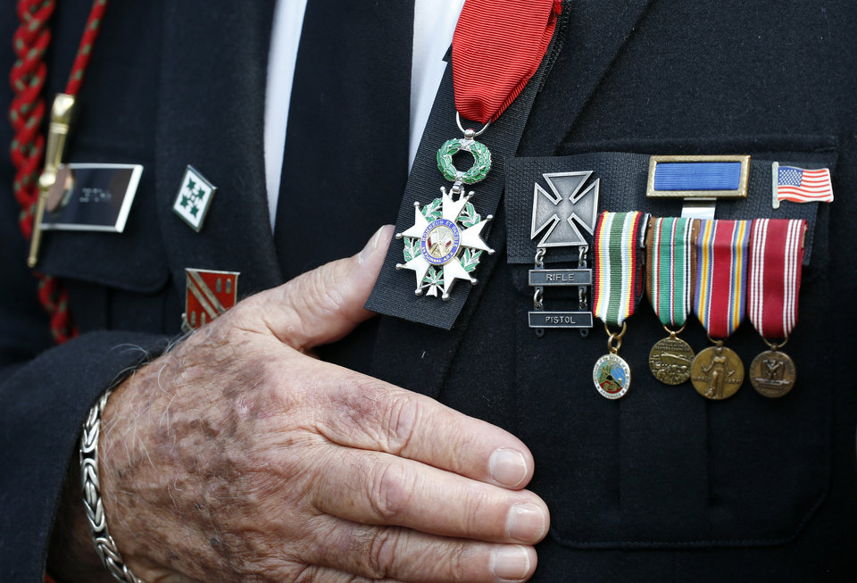 Photo - WWII and D-Day veteran Herman Zeitchik, from Silver Spring, Md., puts his hand over his heart during the National Anthem before a baseball game between the Washington Nationals and the Philadelphia Phillies at Nationals Park Thursday, June 5, 2014, in Washington. (AP Photo/Alex Brandon)