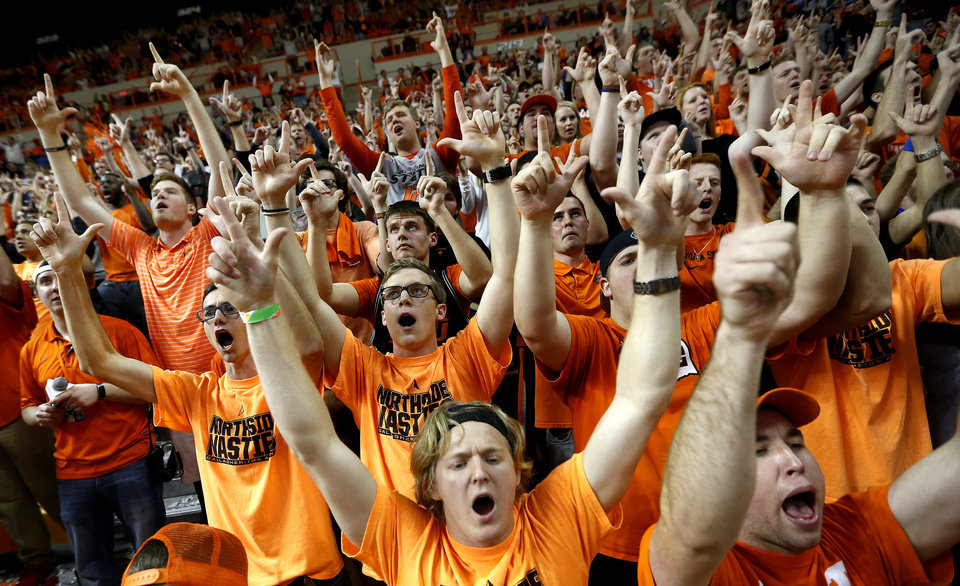 Photo - OSU fans cheer during the men's college basketball game between Oklahoma State University and the University of Kansas at Gallagher-Iba Arena in Stillwater, Okla.,  Saturday, Feb. 7, 2015. OSU won 67-62. Photo by Sarah Phipps, The Oklahoman