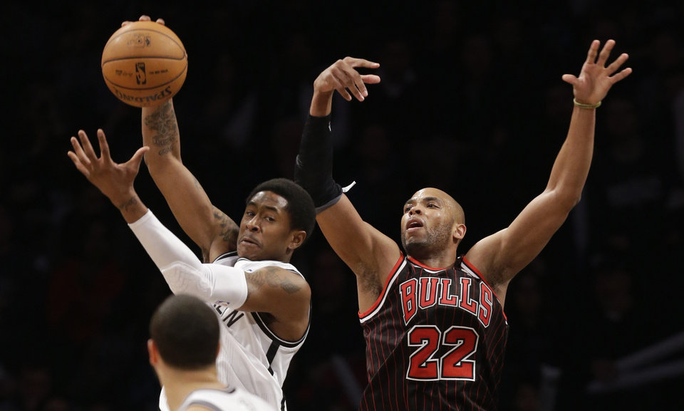 Brooklyn Nets guard MarShon Brooks, top left, steals a pass intended for Chicago Bulls forward Taj Gibson (22) in the first half of an NBA basketball game at the Barclays Center, Friday, Feb. 1, 2013, in New York. (AP Photo/Kathy Willens)