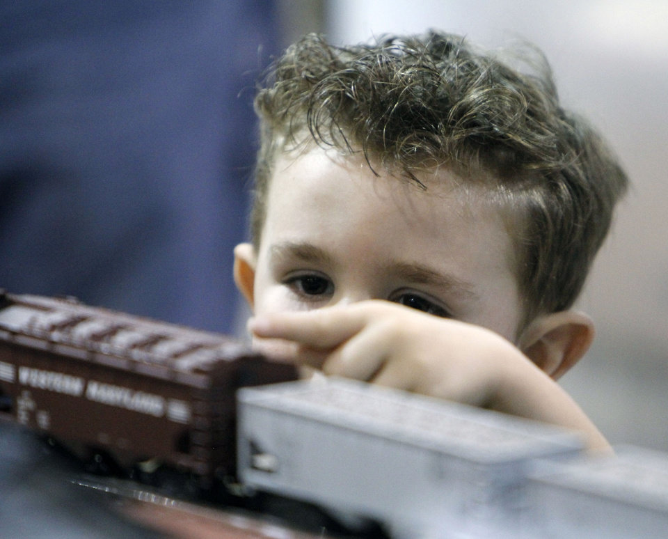 Photo - Three year old Sam Lockhart watches a train during the OKC Train Show at State Fair Park in Oklahoma City, OK, Saturday, December 1, 2012,  By Paul Hellstern, The Oklahoman