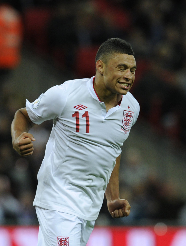 Photo -   England's Alex Oxlade-Chamberlain celebrates scoring their fifth goal during their World Cup Group H qualifying soccer match against San Marino at Wembley Stadium in London, Friday Oct. 12, 2012. (AP Photo/Tom Hevezi)