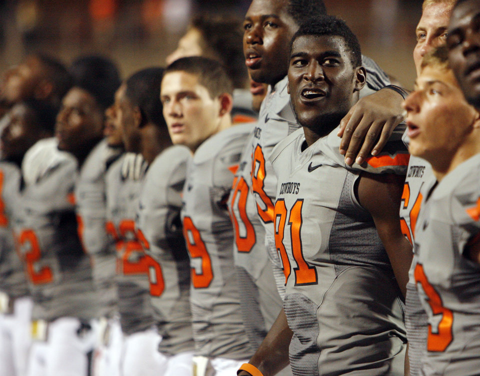 Justin Blackmon (81) and the OSU Caowboys sing the OSU alma mater after their game Saturday. Photo by Nate Billings, The Oklahoman