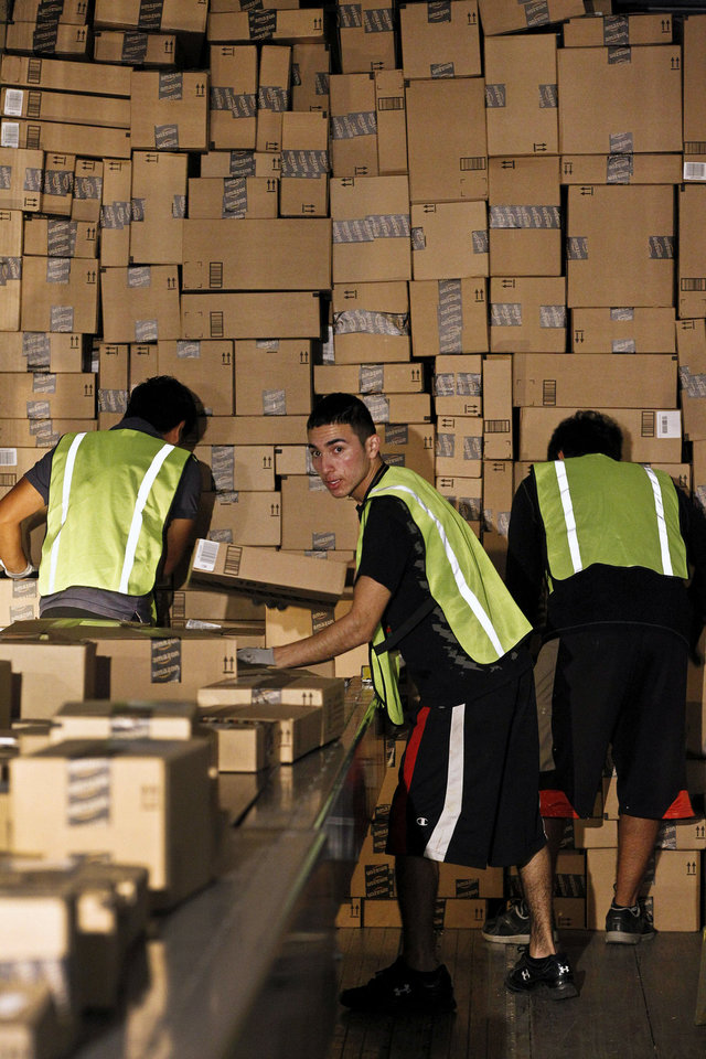 "Workers pack a shipping truck on ""Cyber Monday"" at the Amazon.com fulfillment center in Phoenix. Shoppers were expected to spend $1.5 billion on Cyber Monday, up 20 percent from last year, according to research firm comScore. AP Photo <strong>Ross D. Franklin</strong>"