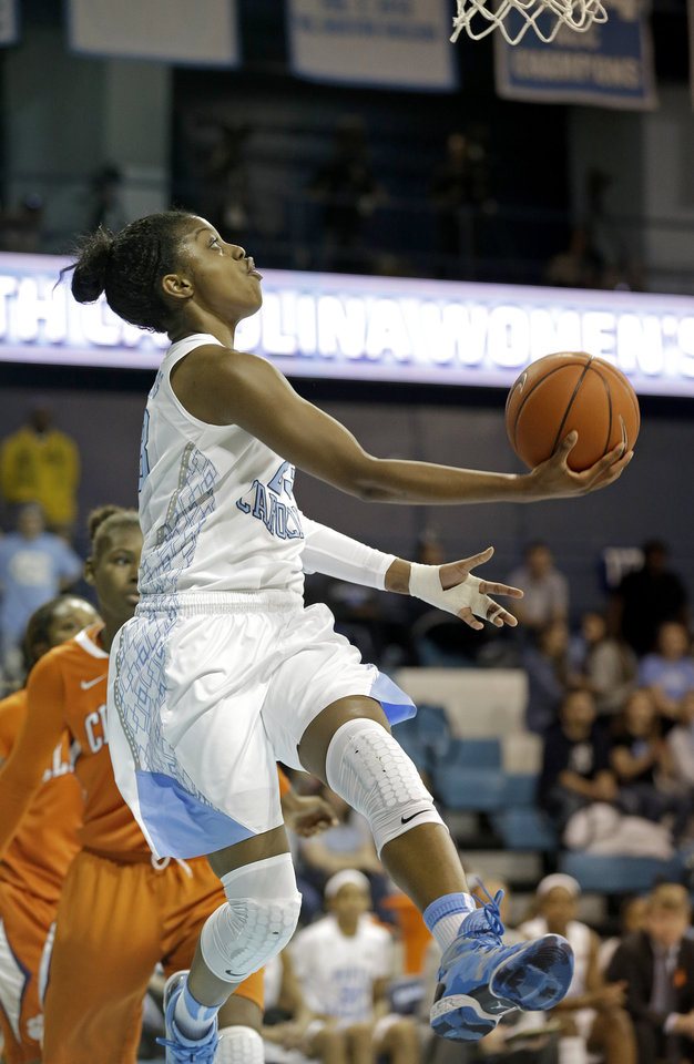 Photo - North Carolina's Diamond DeShields drives to the basket during the second half of an NCAA college basketball game against Clemson in Chapel Hill, N.C., Thursday, Jan. 16, 2014. North Carolina won 78-55. (AP Photo/Gerry Broome)