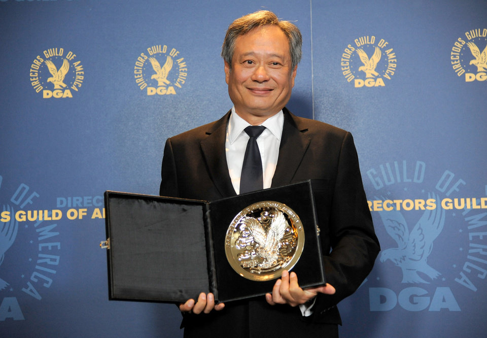 "FILE - In this Saturday, Feb. 2, 2013 file photo, Ang Lee poses backstage with his feature film nomination plaque for ""Life of Pi"" at the 65th Annual Directors Guild of America Awards at the Ray Dolby Ballroom, in Los Angeles.  With 11 Academy Awards nominations, second only to �Lincoln� with 12, and the sort of global box-office receipts normally reserved for superheroes, �Life of Pi� is one of the most unusual megahits ever to hit the big-screen. (Photo by Chris Pizzello/Invision/AP, File)"