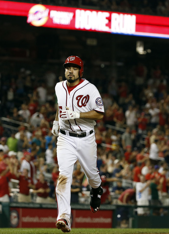 Photo - Washington Nationals' Anthony Rendon heads to home for his solo home run during the seventh inning of an interleague baseball game against the Houston Astros at Nationals Park Wednesday, June 18, 2014, in Washington. The Nationals won 6-5. (AP Photo/Alex Brandon)