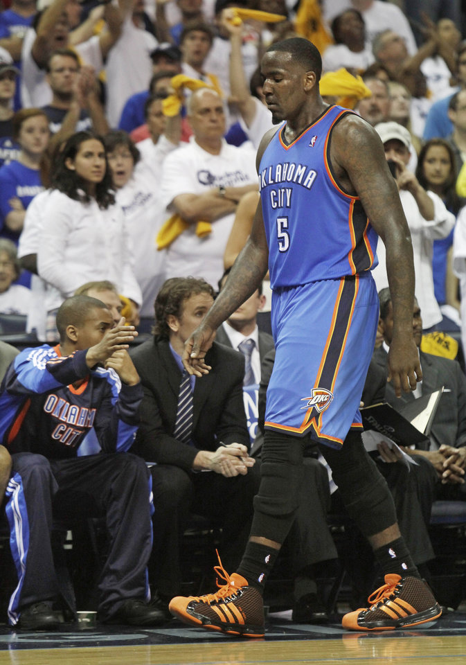 Photo - Oklahoma City Thunder center Kendrick Perkins (5) walks to the bench after fouling out against the Memphis Grizzlies in the overtime period of Game 3 in a second-round NBA basketball series on Saturday, May 7, 2011, in Memphis, Tenn. The Grizzlies won 101-93 in overtime to take a 2-1 lead in the series. (AP Photo/Lance Murphey)