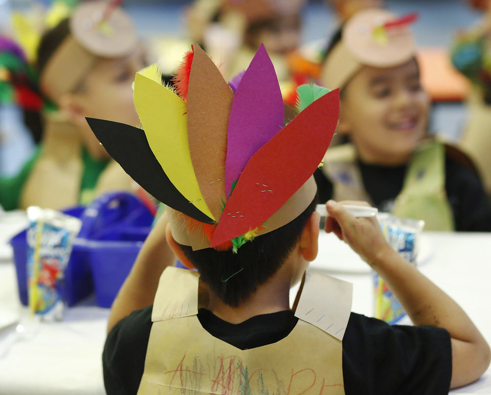 Kindergarten students at Eugene Field Elementary School in Oklahoma City have been learning about Thanksgiving traditions and  the history of the national  holiday in America.  Their teachers helped them make paper sack vests and turkey head pieces to wear.  To celebrate the end of the Thanksgiving lesson and reward the students for working so hard, about 80 students in the four kindergarten classes held a pumpkin pie break in the cafeteria Tuesday afternoon, Nov. 20, 2012. The students dressed in their creative paper sack turkey vests and head dresses.   Photo by Jim Beckel, The Oklahoman