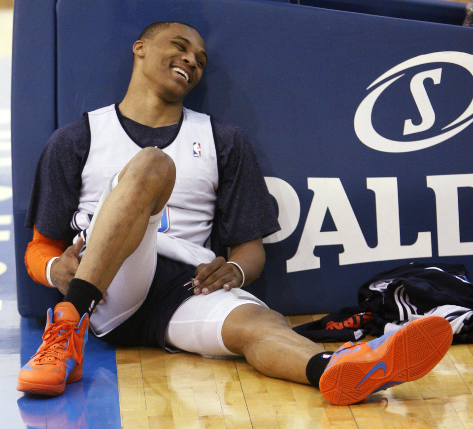Photo -   Oklahoma City Thunder guard Russell Westbrook laughs as he relaxes following a team practice in Oklahoma City, Monday, May 2, 2011. The Memphis Grizzlies face the Oklahoma City Thunder in Game 2 of a second-round NBA basketball playoff series in Oklahoma City on Tuesday. (AP Photo/Sue Ogrocki)