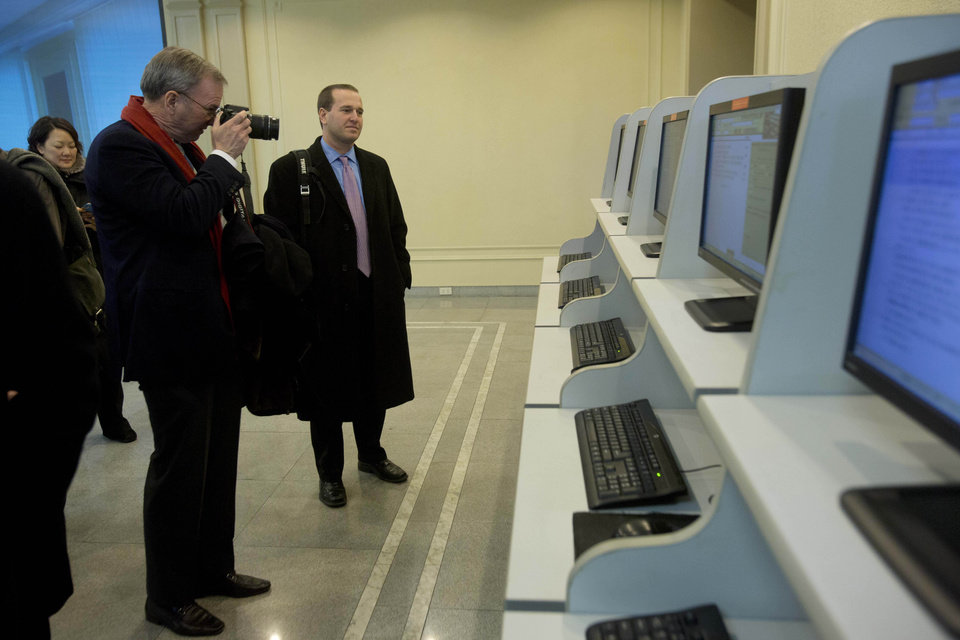 Photo - Executive Chairman of Google, Eric Schmidt, takes photographs as he tours a computer lab at Kim Il Sung University in Pyongyang, North Korea on Tuesday, Jan. 8, 2013. Schmidt is the highest-profile U.S. executive to visit North Korea - a country with notoriously restrictive online policies-since young leader Kim Jong Un took power a year ago. (AP Photo/David Guttenfelder)