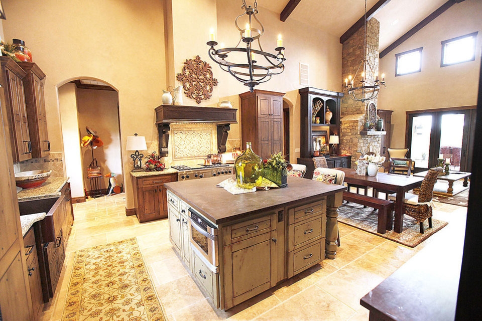 Photo - The kitchen has the look of a lodge at 15820 Chapel Ridge Road.  PAUL HELLSTERN - The Oklahoman